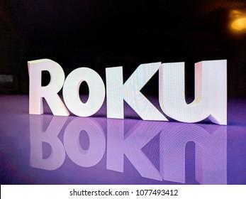 Honolulu - November 14, 2017: Roku Logo on TV screen.  The Roku Streaming Player, or simply Roku, is a series of streaming players manufactured by Roku, Inc.