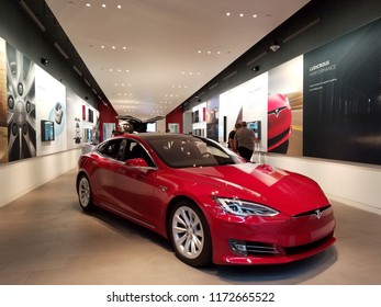 Honolulu - November 17, 2016: People look at Cars inside Tesla Store.  Tesla, Inc. is an American company that specializes in electric vehicles, energy storage and solar panel manufacturing.