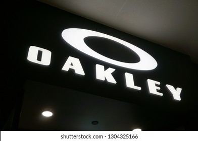 Honolulu - November 26, 2015:  Oakley logo Sign on wall above store in Ala Moana Mall.  Oakley, Inc., based in Lake Forest, California, and a subsidiary of Italian company Luxottica based in Milan.