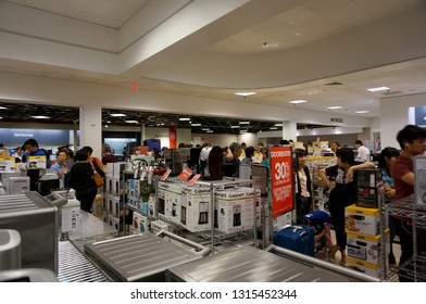 Honolulu - November 26, 2015: People stand in line inside Macy's store on Grey thursday at the Ala Moana shopping center at Ala Moana Shopping center in Honolulu, Hawaii.