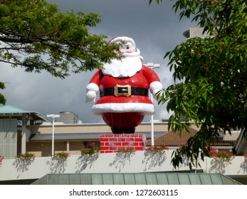 Honolulu - November 9, 2012:  Santa on top of Ala Moana Mall.  Every year Ala Moana Mall places a large Santa Claus on top of parking garage to celebrate Christmas in Hawaii.