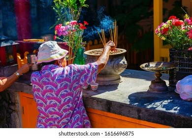 Honolulu, Oahu, Hawaii - November 04, 2019: unidentified woman at a buddhist ceremony in Chinatown, Honolulu. Honolulu is the capital and largest city of the US state of Hawaii