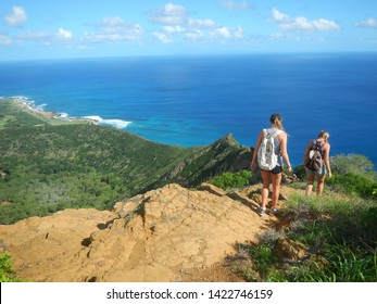Honolulu, Oahu, Hawaii / USA, Nov. 20, 2017: After a steep climb onto top of Koko Crater Railway Trail people will enjoying the spectacular mountain and ocean view
