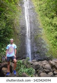 Honolulu, Oahu, Hawaii, USA, Nov. 20, 2017: After a pleasent hike on Manoa Falls Trail people take a break enjoying the spectacular nature and  waterfall