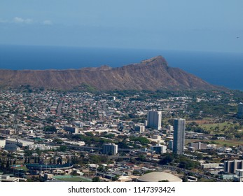 Honolulu - October 14, 2015:  Aerial view of Honolulu Cityscape, Diamondhead, UH Manoa, Ala Wai Golf Course, the gold coast, Pacific ocean, and waves with Helicopter in air on Oahu, Hawaii.