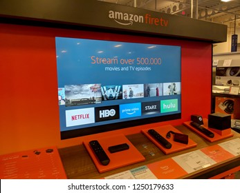 Honolulu - September 7, 2018: Amazon Fire TV Display inside Best Buy Store.  Amazon Fire TV is a digital media player and its microconsole remote developed by Amazon. The device is a streamer.