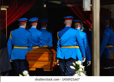 Honor guard carrying a coffin at a funeral