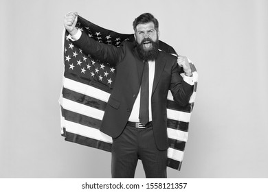 Honour and glory to my country. Happy businessman holding old glory american flag on yellow background. Bearded man in formalwear enjoying glory and success. Hard work brought glory to him.