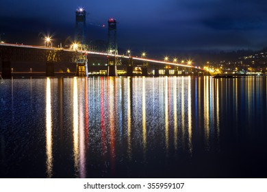 Hood River bridge at night with colorful reflections.  Connects Oregon to Washington over the Columbia River Gorge