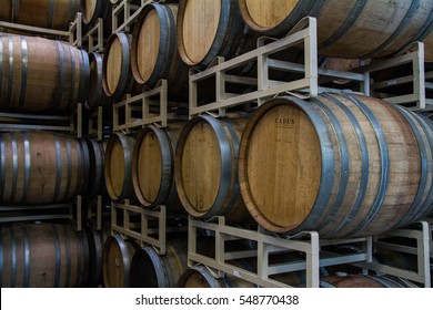 HOOD RIVER, OR - January 2, 2017: Rows of wine barrels age beer, at a local craft brewery