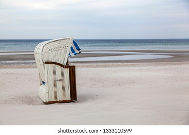 Hooded beach chair at the Baltic Sea in Scharbeutz, Germany