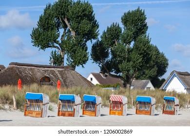 Hooded beach chairs on the beach of Haffkrug, Germany