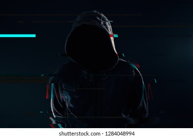 Hooded computer hacker with obscured face, glitch effect