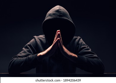 Hooded incognito man. Mysterious man wit hoodie on black background