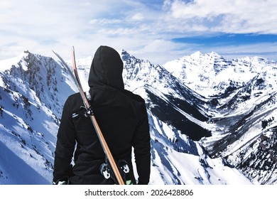 Hooded Person With Skis On Back At Top Of Winter Mountain Extreme Ski Sport Concept