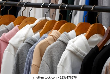 hoodies on hangers in a clothing store, close-up