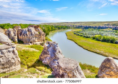 Hoodoo badlands along the Milk River at Writing-on-Stone Provincial Park in Alberta, Canada. The area contains the largest concentration of First Nation petroglyphs and pictographs