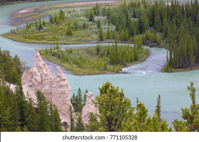 Hoodoos on Tunnel Mountain trail in Banff National Park with Bow River in the background. Hoodoos are composed of sedimentary rock and harder rock underneath.