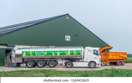 HOOGE ZWALUWE, NETHERLANDS - AUGUST 21, 2018: Large milk tank truck from the Campina dairy company pumps fresh milk from the milk tank of a dairy farm in the village of Hooge Zwaluwe, North Brabant.