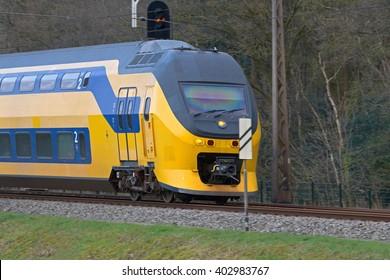 Hoogeveen, Netherlands, April 8, 2016: train railway runs along edge of nature Old Kene in Hoogeveen, Netherlands