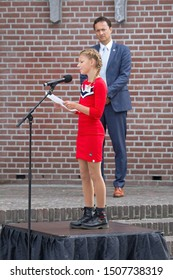 Hoogeveen, the Netherlands - September 18, 2019: The children's poet of Hoogeveen, Denise Scholing, recites a poem to the royal couple Maxima and Willem-Alexander in Hoogeveen, the Netherlands