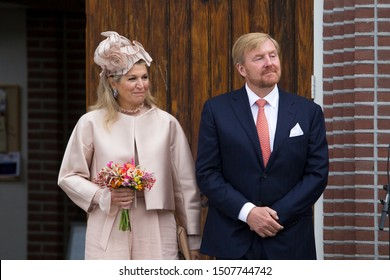 Hoogeveen, the Netherlands - September 18, 2019: Royal couple Maxima and Willem-Alexander are standing in front of the Hoofdstraat church on the Hoofdstraat in Hoogeveen, the Netherlands.