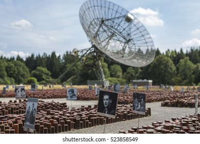 "HOOGHALEN, NETHERLANDS - AUGUST 03, 2014: former concentration camp ""kamp westerbork"" with the radio observatory on the background, in the province Drenthe"