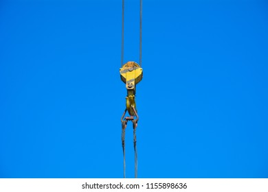 Hook of crane on blue sky background