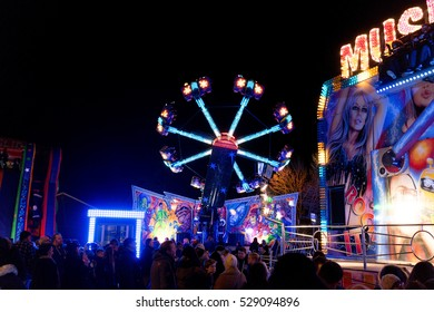 Hook, UK - December, 3 2016: Funfair rides lit up at night time. This is the Hook 'Christmas cracker' fair in Hook, UK.