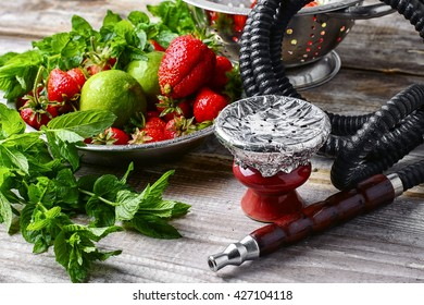 Hookah bowl with tobacco.Eastern hookah with the aroma of lime,strawberry and mint