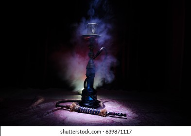 Hookah hot coals on shisha bowl with black background. Stylish oriental shisha. Shisha Concept