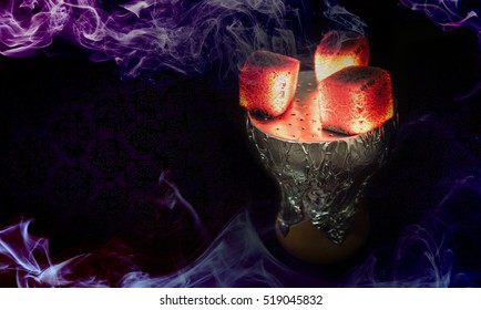 Hookah hot coals for smoking shisha and leisure in east pattern background. Bowl with tobacco and coal. Hookah wallpaper or best shisha art for web.