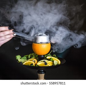 Hookah on orange with mint and citrus fruit