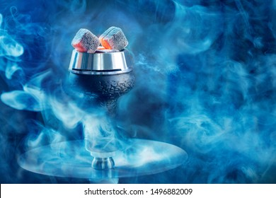 Hookah or shisha hot coals, dark black smoke background.
