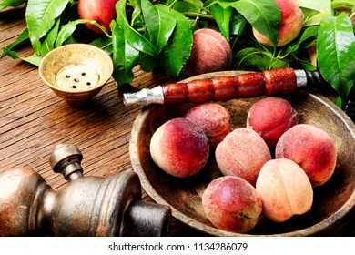 Hookah for smoking with the aroma peach.Peach shisha