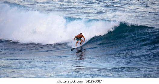 HOOKIPA, HAWAII - DECEMBER 1, 2015: Man surfing at Hookipa, Maui. Hookipa is a beach on the north shore of Maui, Hawaii, USA, perhaps the most renowned windsurfing site in the world.