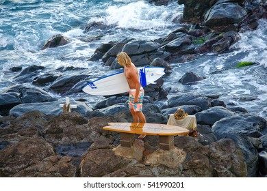 HOOKIPA, HAWAII - DECEMBER 1, 2015: Surfer overlooking the water at Hookipa, Maui. Hookipa is a beach on the north shore of Maui, Hawaii, USA, perhaps the most renowned windsurfing site in the world.