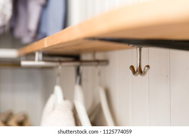 Hooks for clothes in closet