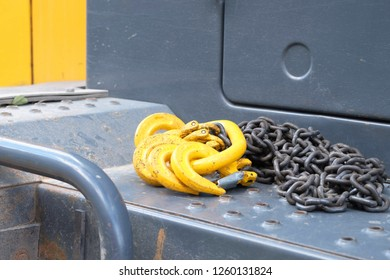 hooks made of metal for lifting loads of yellow lie on the truck, metal objects