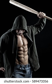 Hooligan with baseball bat, isolated on black background