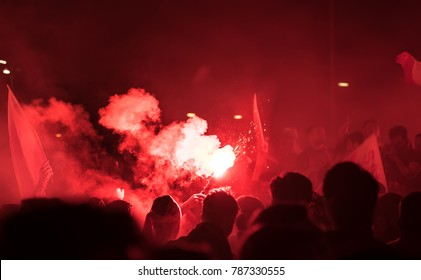 Hooligans ,Flare is ignited and burns bright red at night