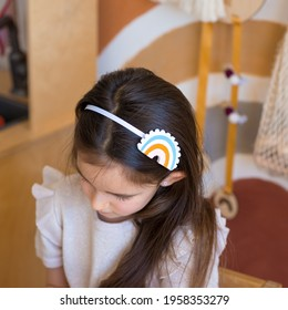 hoop or hairpin rainbow. Children's hairpin rainbow made of felt. The cloud with the sun, the rays are embroidered from beads.