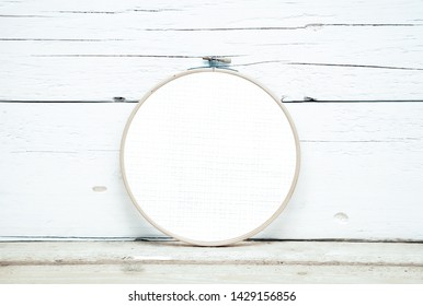 hoops for embroidery on a wooden background - a round layout for embroidery - round hoops for embroidery - a direct view