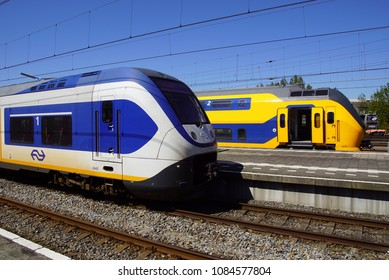 Hoorn, the Netherlands - May 6, 2018: Two Dutch Railway (Dutch: Nederlandse Spoorwegen or NS) electrical passenger trains Sprinter and Intercity standing in the railway station of the  city of Hoorn.
