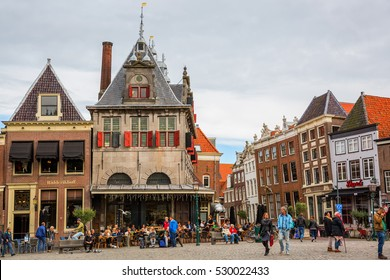 Hoorn, Netherlands - October 08, 2016: square Roode Steen with historical weigh house and unidentified people in Hoorn. Hoorn is a harbor town at the Markermeer, dating back to the 12th century