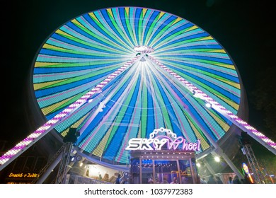 HOORN,THE NETHERLANDS - AUGUST 18 ,2017: Bleu ,green , yellow colors of a ferris wheel at the fairground. Photo taken with a long shutter speed and a 10 mm wide-angle lens.on August 18,2017 in Hoorn.