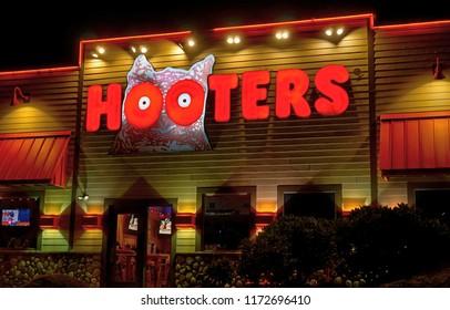 Hooters restaurant front door entrance, logo lighted sign, Saugus Massachusetts USA, August 24, 2018
