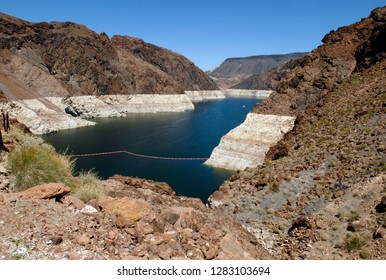 Hoover Dam, Arizona - April 18, 2015: View of Lake Mead / Colorado River near the Hoover Dam, at the Arizona - Nevada border. The high-water mark is clearly seen in white along the shoreline.