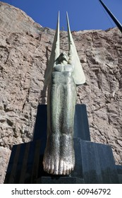 """HOOVER DAM - MAY 7:  Famous statue """"Winged Figures of the Republic"""" greats tourists at the towering and artistic dam on May 7, 2010 at Hoover Dam, Nevada."""