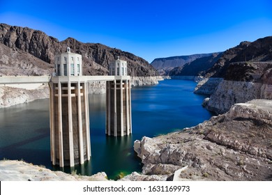 Hoover Dam, Nevada and Arizona. Concrete arch-gravity dam in the Black Canyon of the Colorado River, on the border between the U.S. states of Nevada and Arizona.